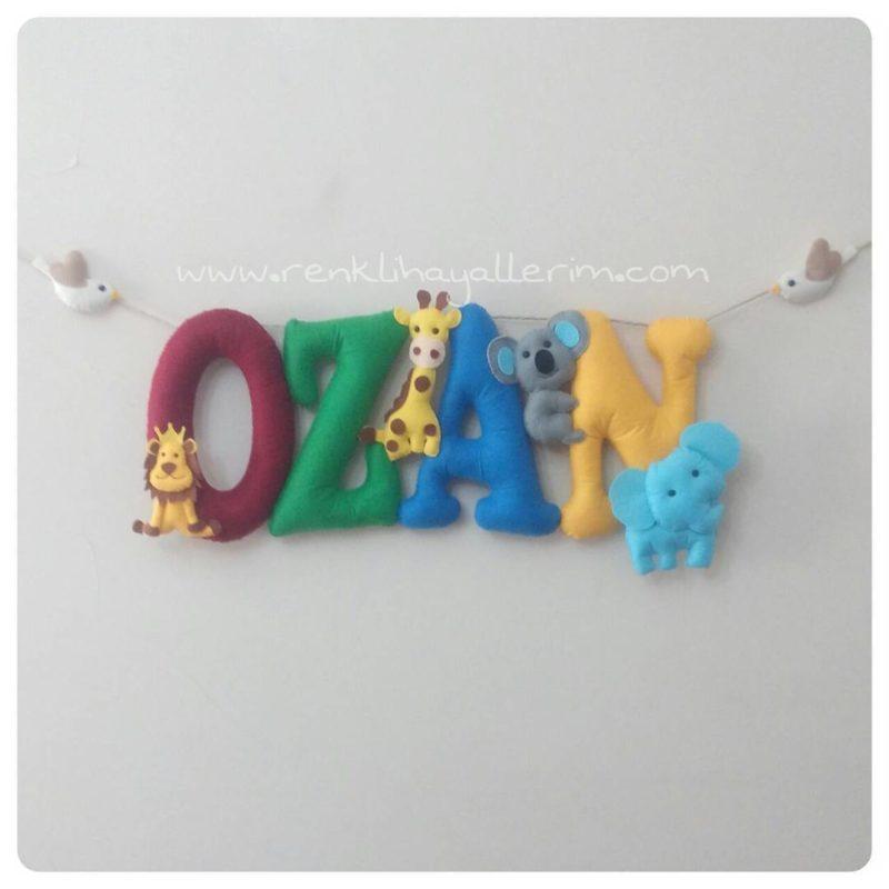 ozan isimli isimlik kapı süsü