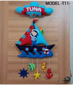 Tuna Mirza bebek isimli denizci kapı süsü