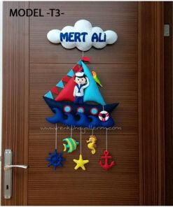 Mert Ali bebek isimli denizci kapı süsü