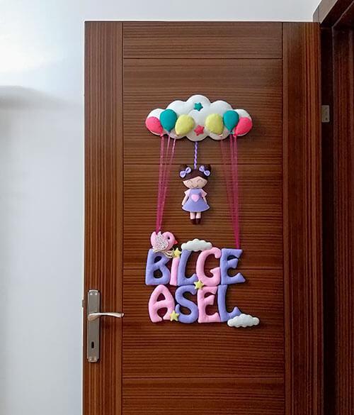 Bilge Asel isimli Pembe Mor Bebek Kapı Süsü