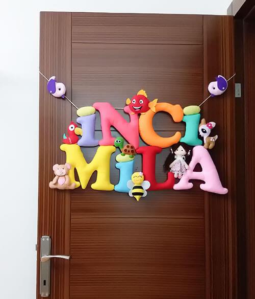 İnci Mila isimli bebek kapı süsü isimlik