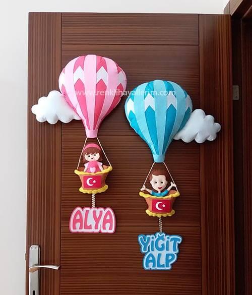 Alya Yiğit Alp isimli keçe bebek kapı süsü modelia